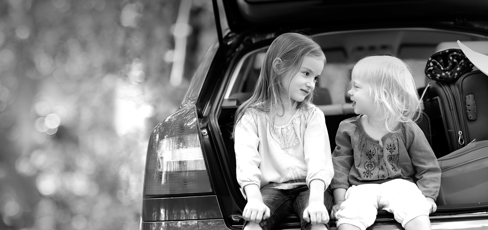 Two Kids on Car